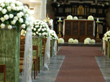 When the budget is bigger.  Order hundreds of white Roses and create the ultimate floral fantasy church wedding./