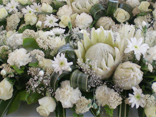 When the budget is bigger.  Order hundreds of white flowers and create the ultimate floral fantasy outdoor wedding/
