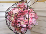 The classic  French way of creating a ball of fresh flowers is kept modern in this edition of floral design magazine.