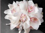 Try this beautiful,fully wired  wedding bouquet with Cymbidium Orchids./