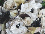 Recycled paper is transformed into  beautiful rosebuds for a black and white wedding.